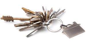 Bunch of different keys on white background